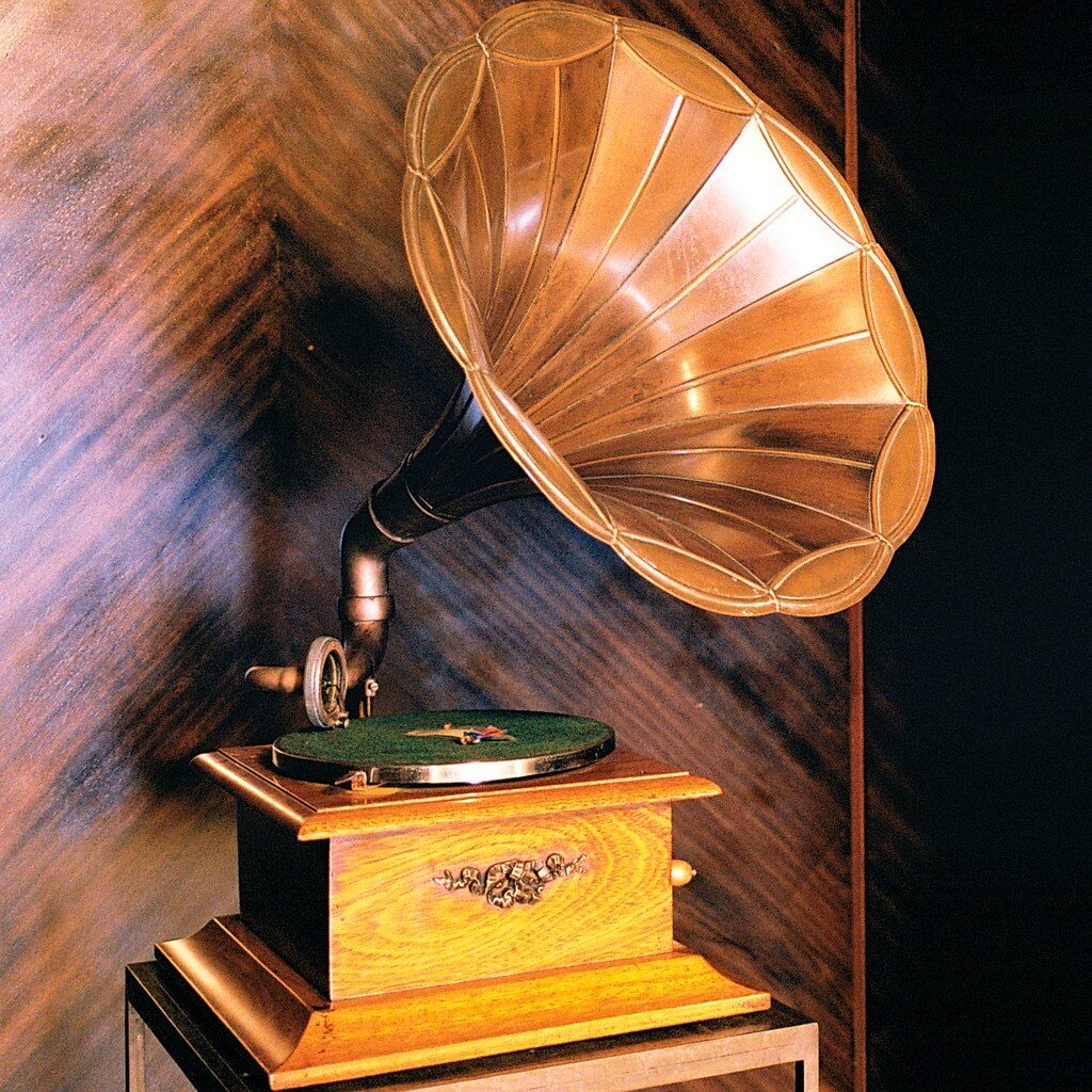 A 1930's to 1950's era phonograph, used to play vinyl records, and love letters or messages from loved ones.